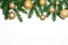 Christmas frame background from xmas tree and golden balls isola. Ted on the white table and copy space for holiday text Royalty Free Stock Photos