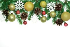 Christmas frame background from xmas tree and golden balls isola. Ted on the white table and copy space for holiday text Royalty Free Stock Image