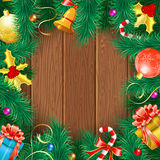 Christmas Frame. With Baubles, Fir Branches, Bell, Gifts and Mistletoe on Wooden Boards. Vector background Royalty Free Stock Photos