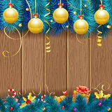 Christmas Frame. With Baubles, Fir Branches, Gold Streamer, Candy, Gift and Confetti on Wooden Background, vector template Stock Photography
