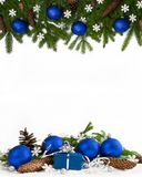 Christmas frame blue baubles four-fifths 2. Christmas decoration  four-fifths with blue baubles, cones and gift on white background Stock Photos