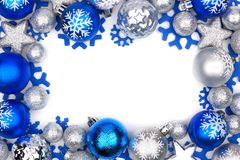 Blue and silver Christmas ornament frame over white. Christmas frame of blue and silver ornaments isolated on a white background stock photography