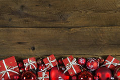 Christmas frame or border with red presents on wooden old backgr Royalty Free Stock Photos