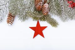 Christmas frame border on white, branches, cones and red star Royalty Free Stock Photography