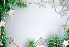 Christmas frame from branch and stars Stock Image
