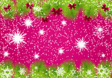 Christmas frame. Bright christmas with tree branches, pink bows and white snowflakes. Space for text Royalty Free Stock Photo