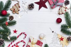 Christmas frame with candy and toys stock images