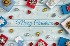 Christmas frame, in the center of the inscription Merry Christmas. White, blue and red gift boxes decorated with silver royalty free stock photo
