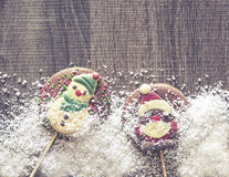 Christmas frame with chocolate figures Royalty Free Stock Images