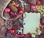 Christmas frame with Christmas decorations, pine cones Royalty Free Stock Images
