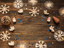 Christmas frame with Christmas ornaments and decorations, snowfl. Akes, angels, snowman, small blue stars, cones on a dark wooden background, add copy or graphic Stock Images