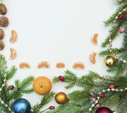 Christmas frame with Christmas ornaments and decorations.tangerines, cloves. Christmas frame with Christmas ornaments and decorations Royalty Free Stock Photography