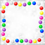 Christmas frame of color balls on blur gray background Royalty Free Stock Photography