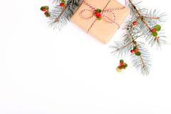 Christmas frame composition. Christmas gift,pine branch, red balls, envelope, white wood snowflakes, ribbon and red berries. Top v. Iew, flat lay, copy space Stock Image
