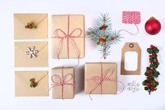 Christmas frame composition. Christmas gift,pine branch, red balls, envelope, white wood snowflakes, ribbon and red berries. Top v. Iew, flat lay, copy space Royalty Free Stock Photos