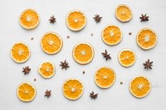 Christmas frame composition with dry oranges and anise stars and seeds. Christmas frame composition with dry oranges and anise stars with seeds over white wooden royalty free stock image