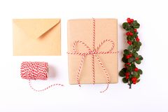 Christmas frame composition. Christmas gift,pine branch, red balls, envelope, white wood snowflakes, ribbon and red berries. Top v. Iew, flat lay, copy space Royalty Free Stock Images