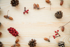 Christmas frame: cones, cinnamon, berries, acorn on the wood table Royalty Free Stock Images