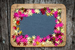 Christmas frame of confetti on blackboard Stock Photos