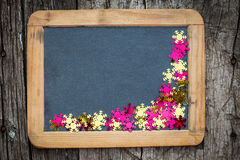 Christmas frame of confetti on blackboard Royalty Free Stock Images