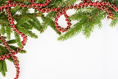 Christmas frame with conifer and red garland Royalty Free Stock Photography