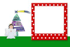 Christmas frame Cute Angel. Copyspace. Picture  frame Christmas backgrounds, cute Angel and fir tree with blank space to write message and funny frame with Royalty Free Stock Photography