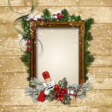 Christmas frame with the decor and the Nutcracker on a wooden ba Royalty Free Stock Images