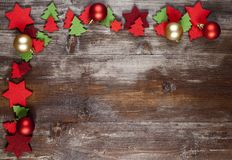 A Christmas Frame decorated with decorations of pannolenci. And red and golden christmas balls Royalty Free Stock Photo