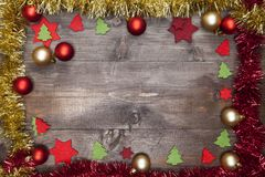 A Christmas Frame decorated with garlands, christmas balls and d. A Christmas Frame decorated with red andgolden garlands, red and golden christmas balls and red Stock Images