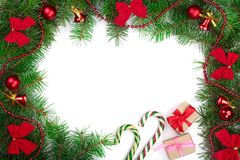 Christmas frame decorated with red bows and balls isolated on white background with copy space for your text. Top view stock photos