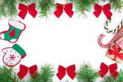 Christmas frame decorated with red bows isolated on white background with copy space for your text.  Stock Photos