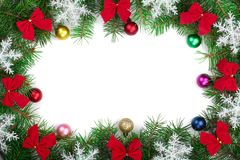 Christmas frame decorated with red bows and snowflakes isolated on white background with copy space for your text. Top view Stock Images