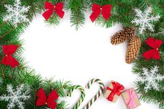 Christmas frame decorated with snowflakes and red bows isolated on white background with copy space for your text stock photo