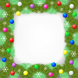 Christmas frame of fir branch decorated balls and snowflakes Stock Photography