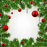 Christmas frame with fir branches and balls. Stock Photos