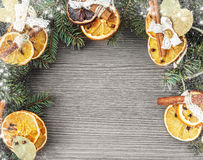 Christmas frame from fir branches and orange decoration Royalty Free Stock Photo