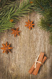 Christmas frame (fir branches, stars, star anise and cinnamon) Stock Photos