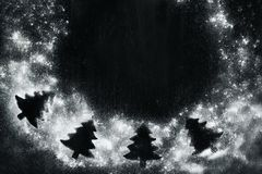 Christmas frame with fir tree silhouettes Stock Photography
