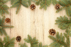 Christmas Frame with Fir Tree Twigs and Pine Cones Stock Photo