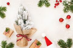 Christmas frame of gifts and fir tree on white background stock photo