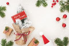 Christmas frame of gifts and Merry Christmas sign on white royalty free stock photo