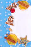 Christmas frame with gingerbread cookies and decorations Stock Photography