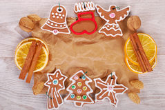 Christmas frame with gingerbread cookies  and spices on old pape Stock Photos