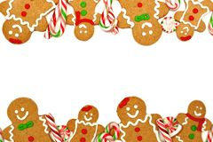 Christmas frame of gingerbread men and candies Royalty Free Stock Images