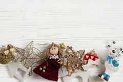 Christmas frame of golden toys. ornament border on white rustic Royalty Free Stock Photography