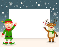 Christmas Frame - Green Elf & Reindeer. Christmas horizontal photo frame with a happy green elf smiling and a cute reindeer holding a candy cane in a snowy Stock Photo