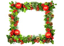 Christmas Frame in Holly. A Christmas frame of red baubles and natural holly with red berries, cones and spring foliage from cypresses with vivid green new Stock Photography
