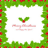 Christmas frame of holly berries Stock Photo