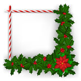 Christmas frame with holly branch and candy Royalty Free Stock Image