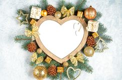 Free Christmas Frame In The Shape Of A Heart Is Surrounded By Branches Of A New Year Tree Christmas Decorations, Isolated On White Royalty Free Stock Image - 133558516